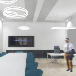 Universitätsklinikum Dresden Dekanatsbüro mit einem langen Tisch und blauen Stühlen und runden Leuchtenelementen